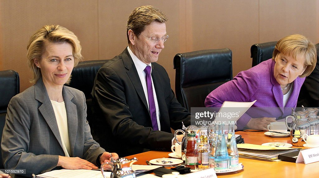 German Labour and Social Affairs Minister Ursula von der Leyen, Foreign Minister Guido Westerwelle and Chancellor Angela Merkel wait for the beginning of a cabinet's meeting on June 2, 2010 in Berlin. Germany's cabinet approved a draft law expanding a ban on naked short selling to include all stocks traded on the German market, a government spokesman told AFP.