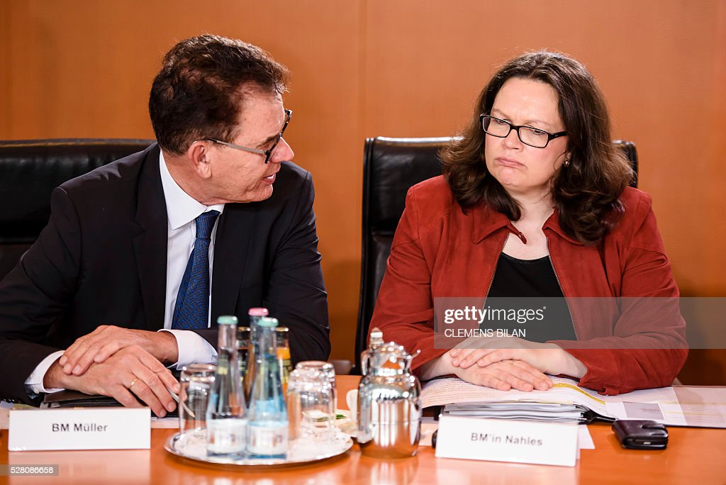 German Labour and Social Minister Andrea Nahles (R) talks with German Development Minister Gerd Mueller prior to the weekly cabinet meeting at the Federal Chancellery in Berlin, on May 4, 2016. / AFP / CLEMENS