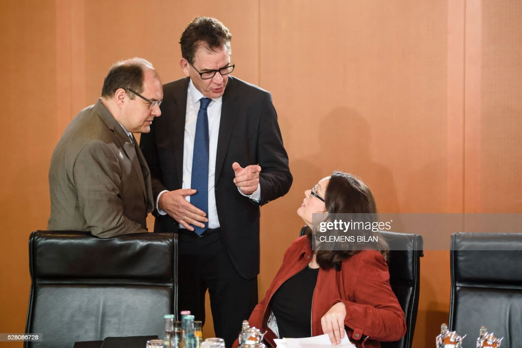 German Labour and Social Minister Andrea Nahles (R) talks with German Development Minister Gerd Mueller (C) and German Agriculture Minister Christian Schmidt (L) prior to the weekly cabinet meeting at the Federal Chancellery in Berlin, on May 4, 2016. / AFP / CLEMENS