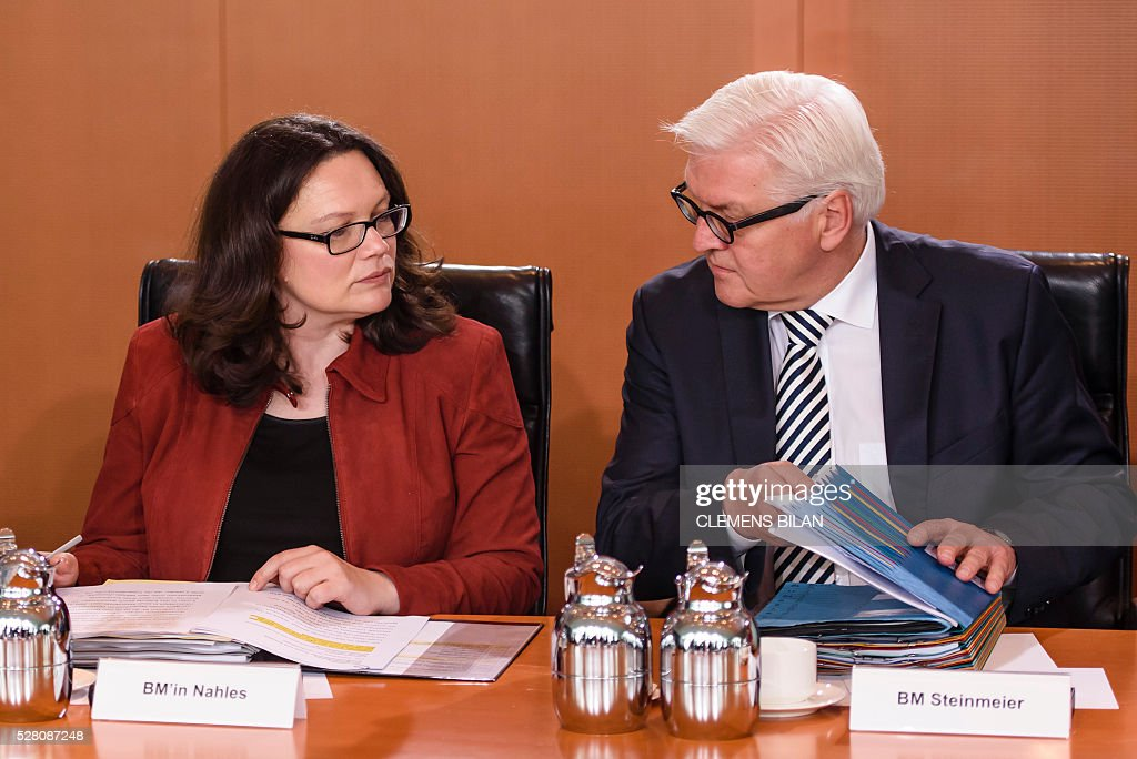 German Labour and Social Minister Andrea Nahles (L) talks with German Foreign Minister Frank-Walter Steinmeier prior to the weekly cabinet meeting at the Federal Chancellery in Berlin, on May 4, 2016. / AFP / CLEMENS