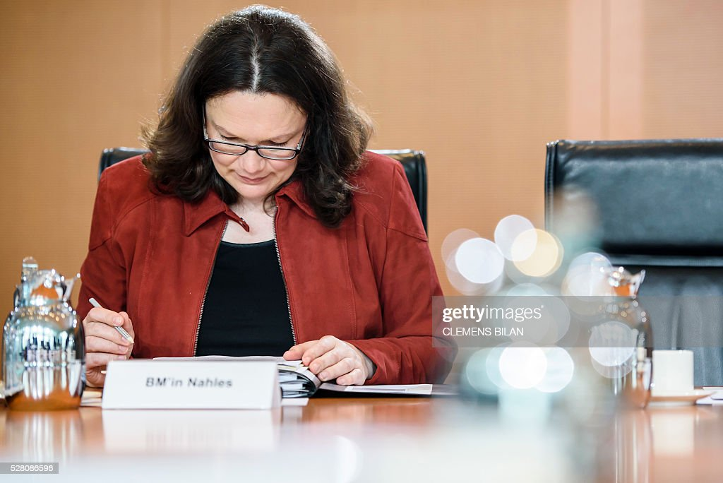 German Labour and Social Minister Andrea Nahles waits for the start of the weekly cabinet meeting at the Federal Chancellery in Berlin, on May 4, 2016. / AFP / CLEMENS