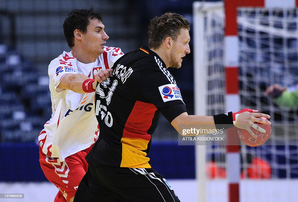 German Lars Kaufmann (R) vies with Polish Krzysztof Lijewski (L) during the Men's EHF Euro 2012 Handball Championship match Poland vs Germany on January 25, 2012 at the Belgrade Arena.