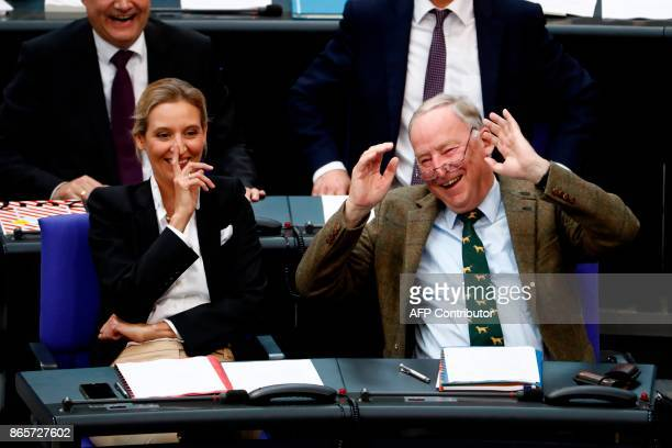 German leaders of the parliamentary group of the Alternative for Germany farright party Alexander Gauland and Alice Weidel react to a comment made by...