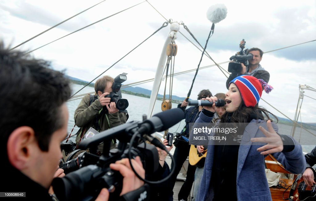 German Lena Meyer-Landrut (R) rehearses with her band on the sailing ship 'Christian Radich' in Oslo, Norway on May 25, 2010. Meyer-Landrut will represent Germany at this year's Eurovision Song Contest, taking place on May 29, 2010 in Oslo.