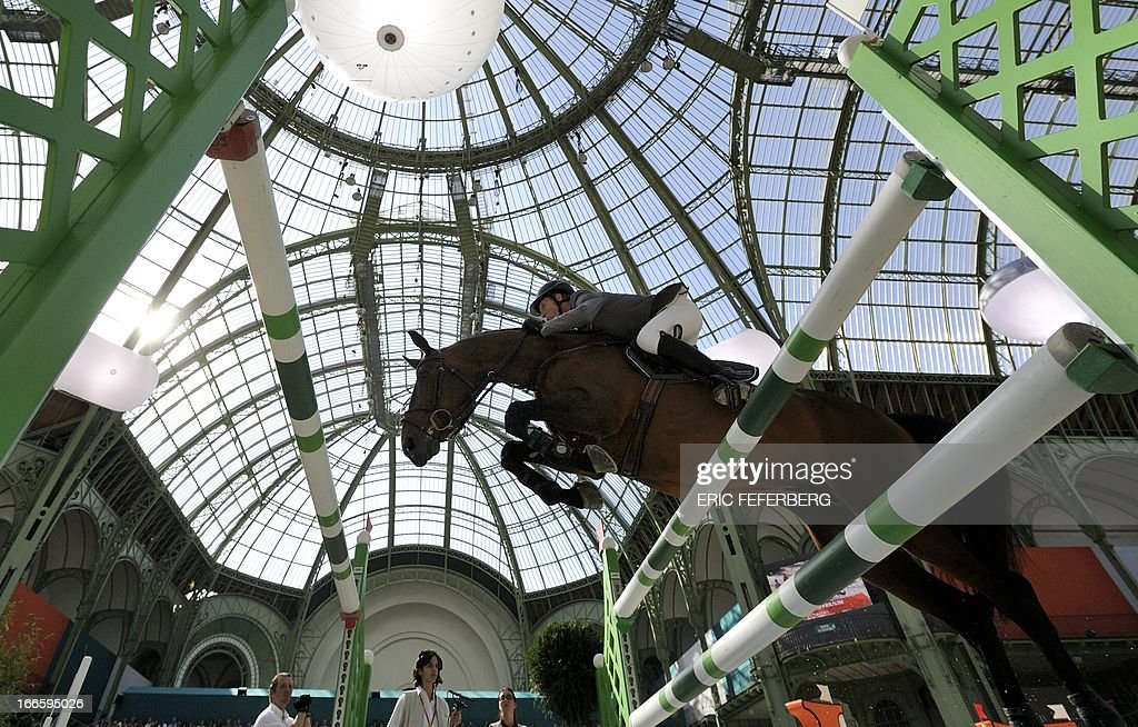 German Ludger Beerbaum on Chaman competes during the 'Grand Prix Hermes' international jumping competition at the Grand Palais in Paris on April 14, 2013.