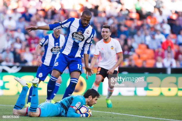 German Lux and Sidnei Rechel Da Silva of Deportivo de la Corua during their La Liga match between Valencia CF and Deportivo de la Corua at the...