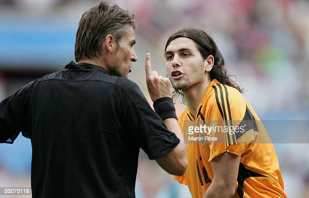 German Lux goalkeeper of Argentina discuss with referee Roberto Rosetti of Italy during the FIFA Confederations Cup Match between Argentina and...