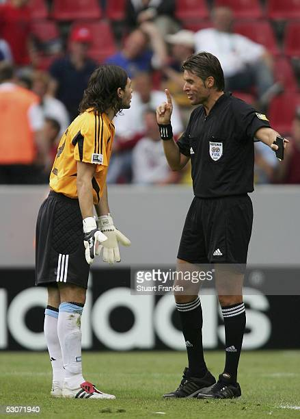 German Lux of Argentina makes a piont to referee Roberto Roseti during The FIFA Confederations Cup Match between Argentina and Tunisia at The Rhein...