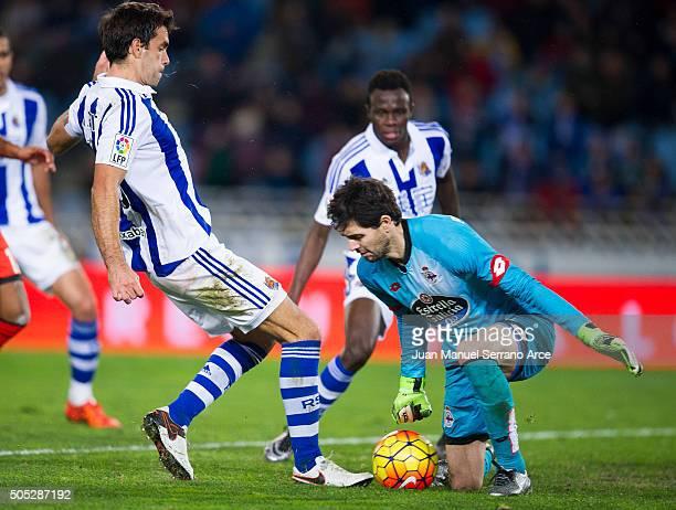 German Lux of Deportivo La Coruna duels for the ball with Xabier Prieto of Real Sociedad during the La Liga match between Real Sociedad de Futbol and...