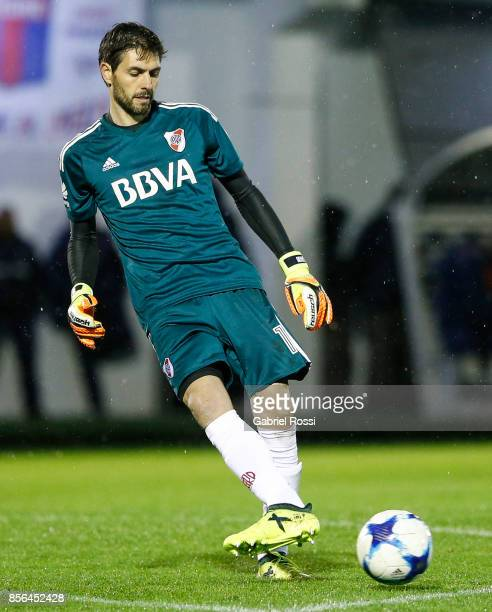 German Lux of River Plate kicks the ball during a match between Tigre and River Plate as part of Superliga 2017/18 at Jose Dellagiovanna Stadium on...