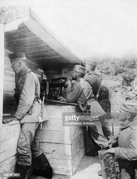 A German machine gun crew firing upon the enemy 200 meters away July 15 1916 The crew is under a bomb proof shelter and is firing 600 bullets a minute