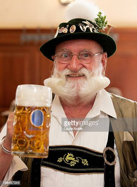 German man in lederhosen with beer in Hofbrauhaus