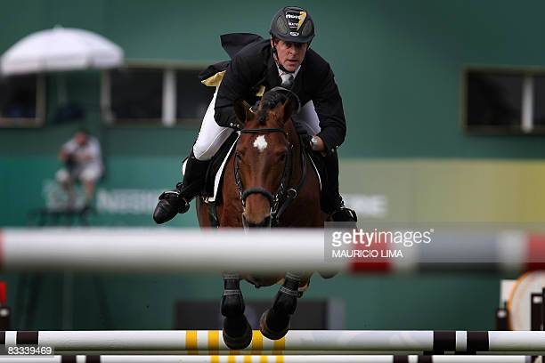 German Marcus Ehning atop his horse Vulkano FRH jumps an obtacle during the Global Champions Tour 160m jumpoff Grand Prix final of the 2nd Athina...