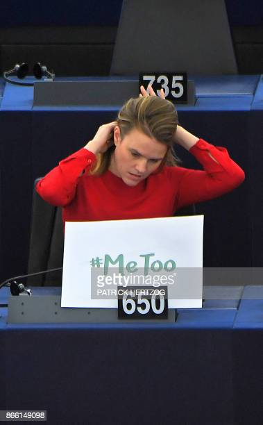 German MEP Terry Reintke sits with a '#metoo' placard during a debate about combating sexual harassment and abuse in the EU at the European...
