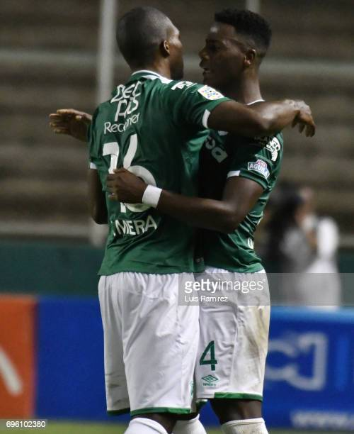 German Mera of Deporivo Cali celebrates with teammate Daniel Rosero Valencia after scoring the first goal of his team during the Final first leg...