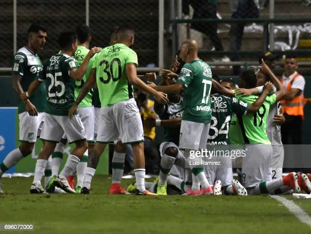 German Mera of Deporivo Cali celebrates with teammates after scoring the first goal of his team during the Final first leg match between Deportivo...