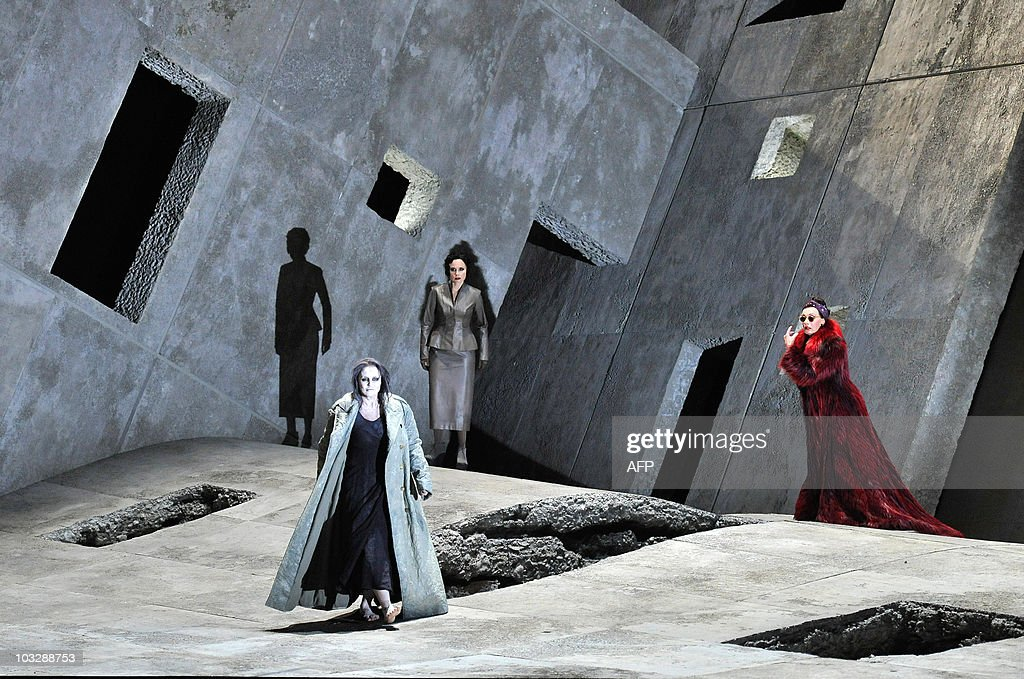 German mezzo-soprano Waltraud Meier (R) in the role of Klytaemnestra and Swedish soprano Irene Theorin (C) in the role of Elektra perform during a dress rehearsal of the opera 'Elektra' composed by Richard Strauss, on August 4, 2010 in Salzburg. The premiere of the opera will be presented on August 8, 2010 during The Salzburg Festival, the annual high-brow culture fest celebrating this year its 90th anniversary.