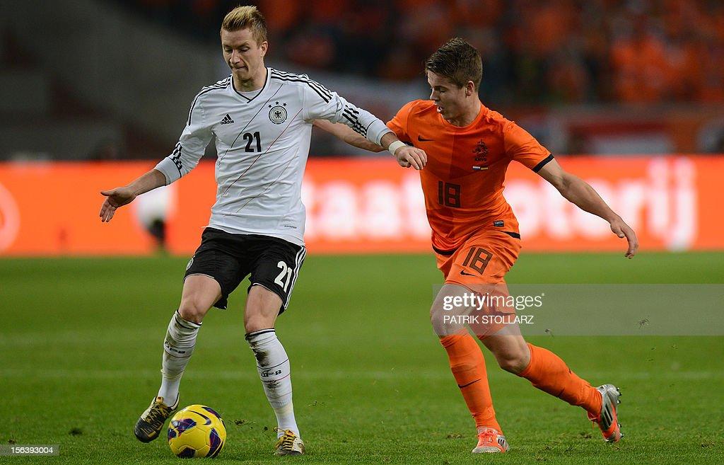 German midfielder Marco Reus and Dutch midfielder Marco van Ginkel during the friendly football match Netherlands vs Germany on November 14, 2012 in Amsterdam.