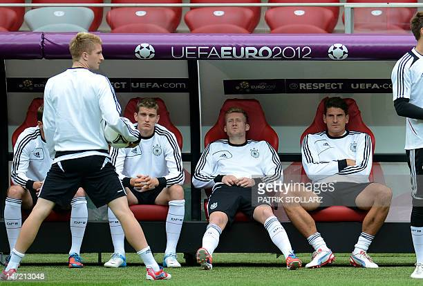 German midfielder Marco Reus German midfielder Lars Bender German forward Andre Schuerrle and German forward Mario Gomez attend a training session at...