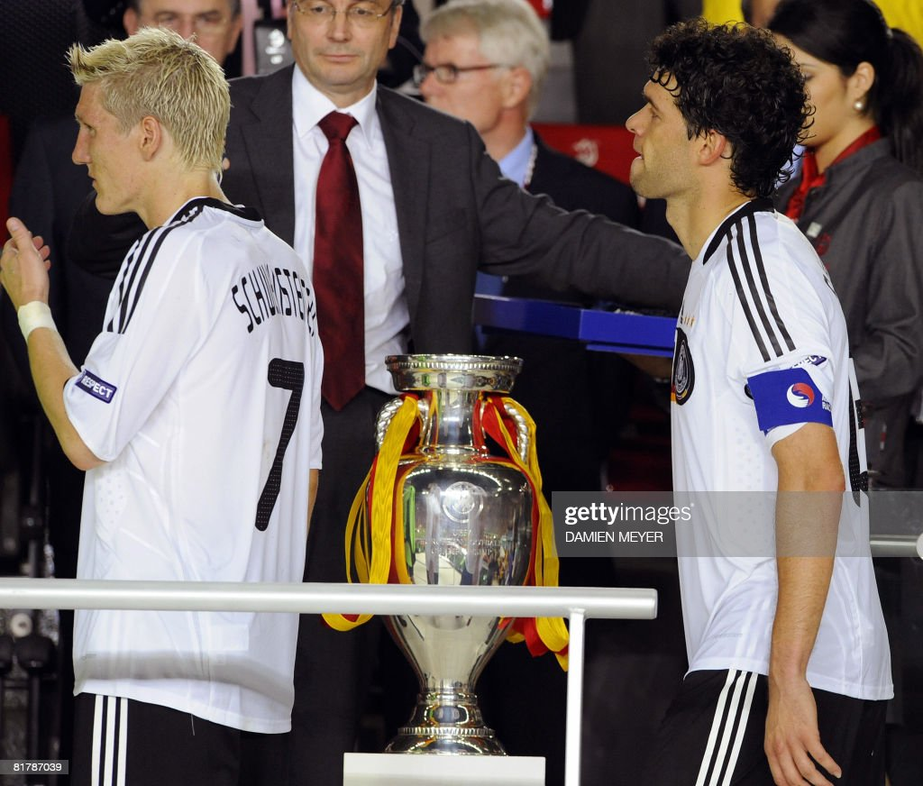 German midfielders <a gi-track='captionPersonalityLinkClicked' href=/galleries/search?phrase=Bastian+Schweinsteiger&family=editorial&specificpeople=203122 ng-click='$event.stopPropagation()'>Bastian Schweinsteiger</a> (L) and Michael Ballack walk by the trophy after Spain won the Euro 2008 championships final football match Germany vs. Spain on June 29, 2008 at Ernst-Happel stadium in Vienna, Austria. Spain ended their 44-year wait for a major international title with a 1-0 victory over Germany at the Euro 2008 final. AFP PHOTO / DAMIEN MEYER -- MOBILE SERVICES OUT --
