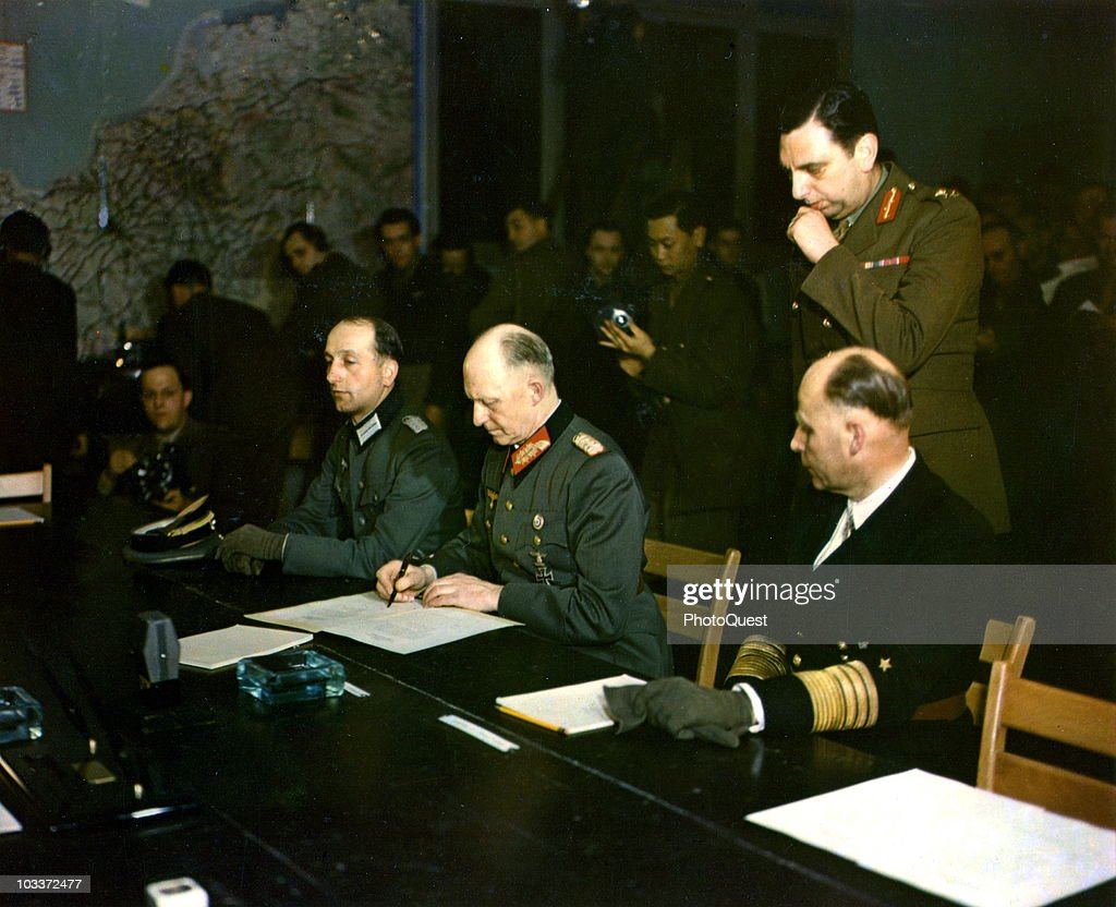 German military commander Generaloberst (Colonel General ) <a gi-track='captionPersonalityLinkClicked' href=/galleries/search?phrase=Alfred+Jodl&family=editorial&specificpeople=93062 ng-click='$event.stopPropagation()'>Alfred Jodl</a> (1890 - 1946) (center) signs the German Instrument of Surrender, Reims, France, May 7, 1945. Seated on his right is Major Wilhelm Oxenius (1912 - 1979) and Admiral <a gi-track='captionPersonalityLinkClicked' href=/galleries/search?phrase=Hans-Georg+von+Friedeburg&family=editorial&specificpeople=217308 ng-click='$event.stopPropagation()'>Hans-Georg von Friedeburg</a> (1895 - 1945) is on his left (in the dark uniform).