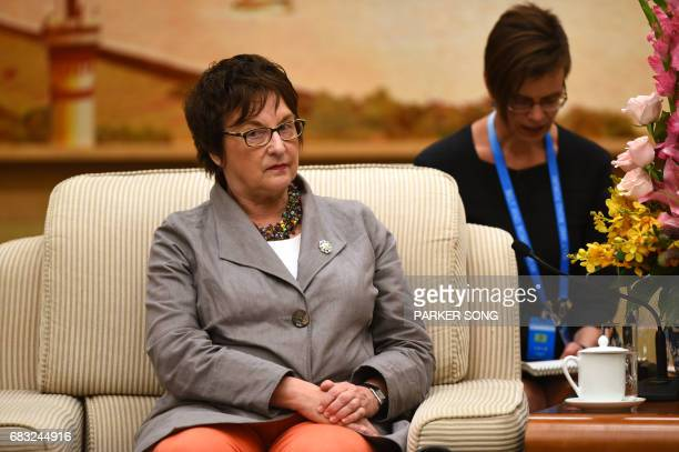 German Minister for Economic Affairs and Energy Brigitte Zypries attends a meeting with Chinese Premier Li Keqiang at the Great Hall of the People in...