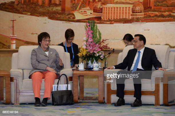 German Minister for Economic Affairs and Energy Brigitte Zypries talks to Chinese Premier Li Keqiang during their meeting on May 15 2017 at the Great...