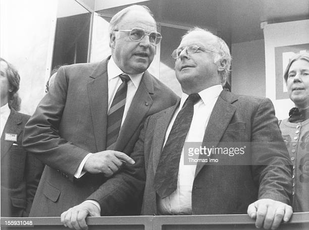 German Minister for Employment Norbert Bluem and German Federal Chancellor Helmut Kohl talking to each other April 19 Bonn Germany