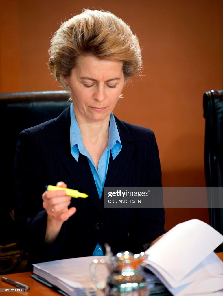 German minister for labour and social affairs Ursula Von der Leyen take notes while reading her brief during the weekly cabinet meeting at the Chancellery in Berlin on February 27, 2013. ANDERSEN