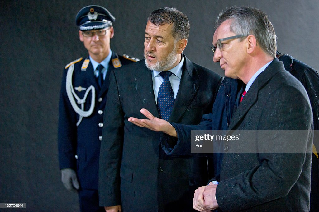 German Minister of Defense <a gi-track='captionPersonalityLinkClicked' href=/galleries/search?phrase=Thomas+de+Maiziere&family=editorial&specificpeople=618845 ng-click='$event.stopPropagation()'>Thomas de Maiziere</a> (R) and the Afghan Minister of Defense S.E. <a gi-track='captionPersonalityLinkClicked' href=/galleries/search?phrase=Bismillah+Khan+Mohammadi&family=editorial&specificpeople=5958208 ng-click='$event.stopPropagation()'>Bismillah Khan Mohammadi</a> during a wreath laying on October, 24 in Berlin, Germany. The focus of the meeting are to review the security situation, the presidential election of 2014, the potential follow-on mission 'Resolute Support' and a possible further use of infrastructure in 'Mazar-e-Sharif' by Afghan authorities.