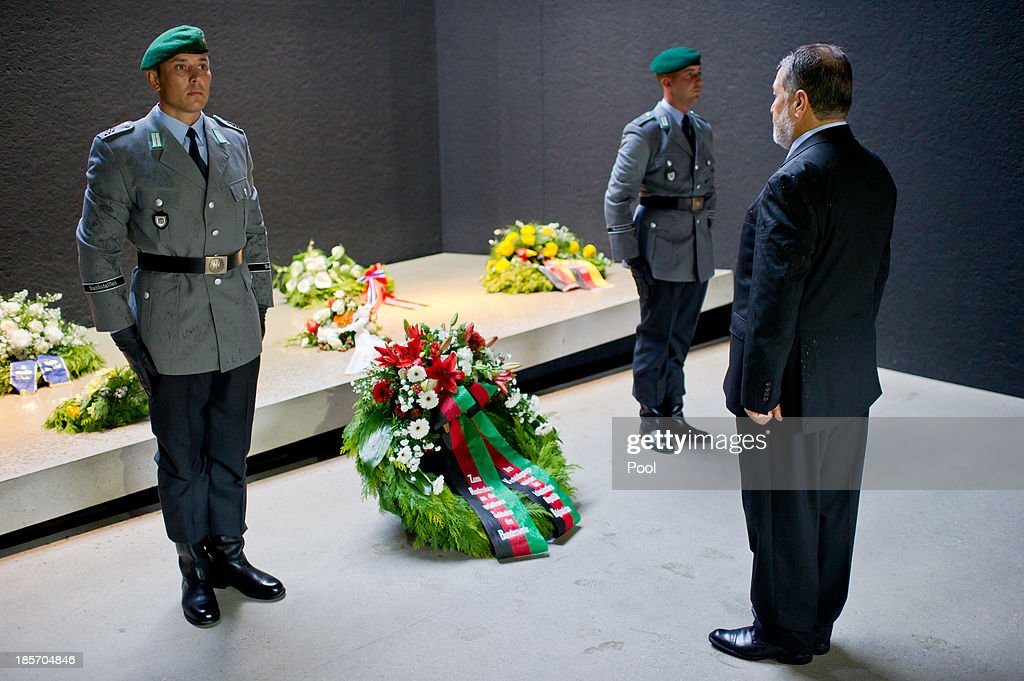German Minister of Defense Thomas de Maiziere (Not Pictured) and the Afghan Minister of Defense S.E. <a gi-track='captionPersonalityLinkClicked' href=/galleries/search?phrase=Bismillah+Khan+Mohammadi&family=editorial&specificpeople=5958208 ng-click='$event.stopPropagation()'>Bismillah Khan Mohammadi</a> during a wreath laying on October, 24 in Berlin, Germany. The focus of the meeting are to review the security situation, the presidential election of 2014, the potential follow-on mission 'Resolute Support' and a possible further use of infrastructure in 'Mazar-e-Sharif' by Afghan authorities.