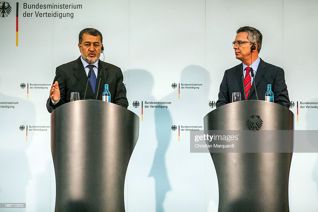 German Minister of Defense <a gi-track='captionPersonalityLinkClicked' href=/galleries/search?phrase=Thomas+de+Maiziere&family=editorial&specificpeople=618845 ng-click='$event.stopPropagation()'>Thomas de Maiziere</a> (R) and the Afghan Minister of Defense <a gi-track='captionPersonalityLinkClicked' href=/galleries/search?phrase=Bismillah+Khan+Mohammadi&family=editorial&specificpeople=5958208 ng-click='$event.stopPropagation()'>Bismillah Khan Mohammadi</a> talk to the media after there meeting on October, 24 in Berlin, Germany. The focus of the meeting are to review the security situation, the presidential election of 2014, the potential follow-on mission 'Resolute Support' and a possible further use of infrastructure in Mazar-e-Sharif by Afghan authorities.