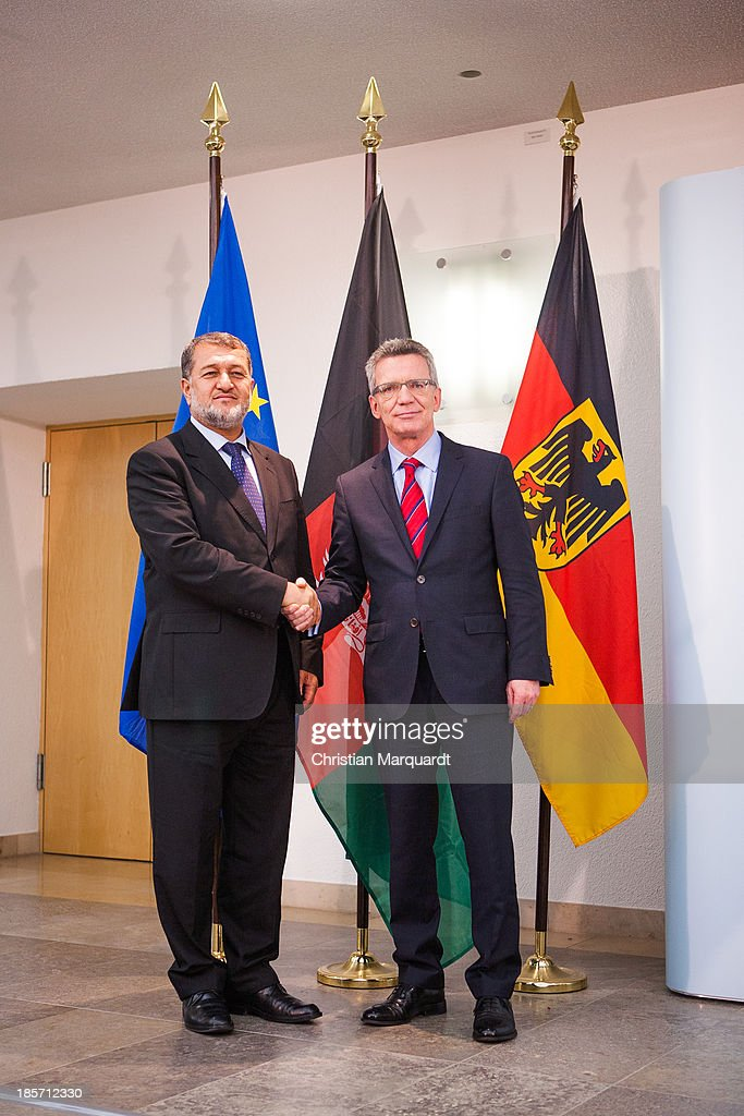 German Minister of Defense <a gi-track='captionPersonalityLinkClicked' href=/galleries/search?phrase=Thomas+de+Maiziere&family=editorial&specificpeople=618845 ng-click='$event.stopPropagation()'>Thomas de Maiziere</a> (R) and the Afghan Minister of Defense <a gi-track='captionPersonalityLinkClicked' href=/galleries/search?phrase=Bismillah+Khan+Mohammadi&family=editorial&specificpeople=5958208 ng-click='$event.stopPropagation()'>Bismillah Khan Mohammadi</a> shake hands after there meeting on October, 24 in Berlin, Germany. The focus of the meeting are to review the security situation, the presidential election of 2014, the potential follow-on mission 'Resolute Support' and a possible further use of infrastructure in Mazar-e-Sharif by Afghan authorities.
