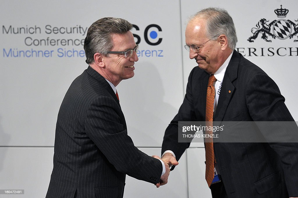 German Minister of Defense Thomas de Maiziere (L) shakes hands with Wolfgang Ischinger, organizer of the Munich Security Conference, during the opening session of the event on February 1, 2013 in Munich, southern Germany as world leaders, ministers and top military gather for talks with the spotlight on Syria, Mali and Iran.