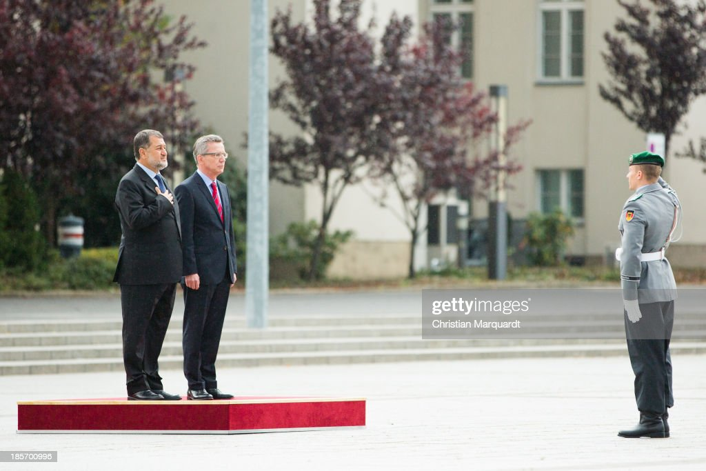 German Minister of Defense <a gi-track='captionPersonalityLinkClicked' href=/galleries/search?phrase=Thomas+de+Maiziere&family=editorial&specificpeople=618845 ng-click='$event.stopPropagation()'>Thomas de Maiziere</a> welcomes the Afghan Minister of Defense S.E. <a gi-track='captionPersonalityLinkClicked' href=/galleries/search?phrase=Bismillah+Khan+Mohammadi&family=editorial&specificpeople=5958208 ng-click='$event.stopPropagation()'>Bismillah Khan Mohammadi</a> with military honor on October, 24 in Berlin, Germany. The focus of the meeting are to review the security situation, the presidential election of 2014, the potential follow-on mission 'Resolute Support' and a possible further use of infrastructure in 'Mazar-e-Sharif' by Afghan authorities.