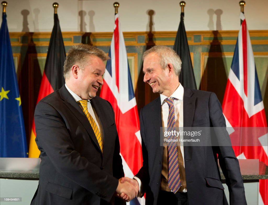 German Minister of State Michael Georg Link shakes hands with British Minister for Europe David Lidington after they give a press conference during the third German-British consultations on Europe on January 14, 2013 in Berlin, Germany. The focus of the consultation are the Economic and Monetary Union and for both views on the future of the European Union.