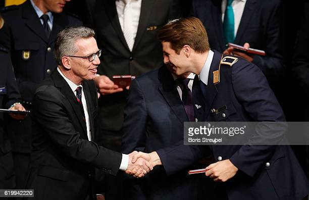 German Minister of the Interior Thomas de Maiziere awards rower Richard Schmidt the Silbernes Lorbeerblatt during the Silbernes Lorbeerblatt Award...