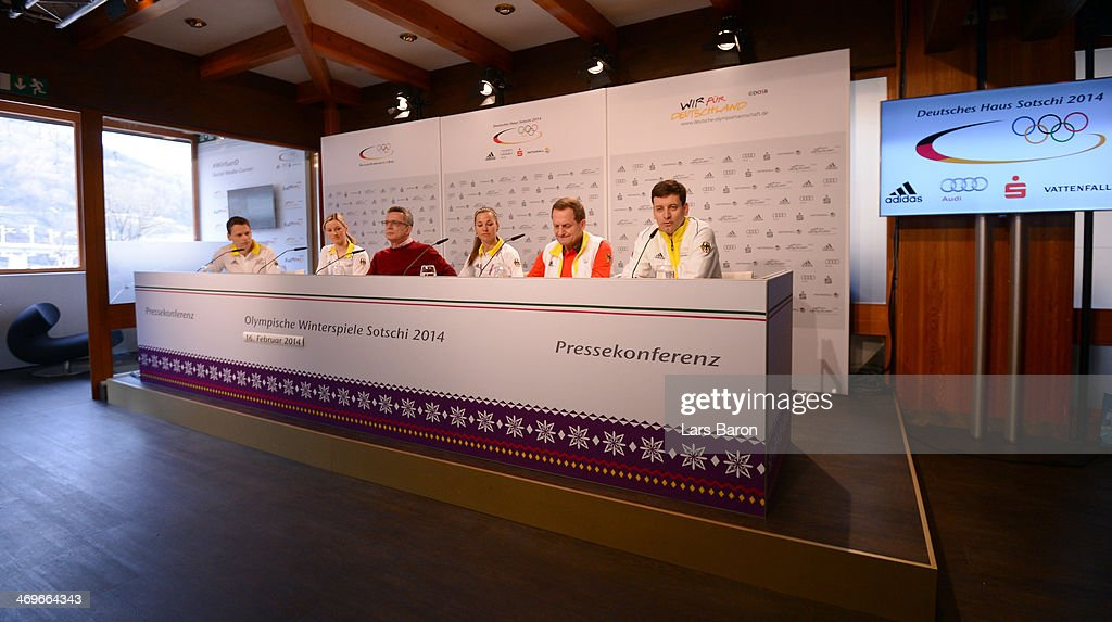 German Minister of the Interior Thomas de Maiziere is seen on the podium with <a gi-track='captionPersonalityLinkClicked' href=/galleries/search?phrase=Denise+Herrmann&family=editorial&specificpeople=6670680 ng-click='$event.stopPropagation()'>Denise Herrmann</a>, Stefanie Boehler, president of the German Olympic Sports Confederation Alfons Hoermann and Bjoern Kircheisen during a press conference at the 'Deutsche Haus' in Krasnaya Polyana on day 9 of the Sochi 2014 Winter Olympics on February 16, 2014 in Sochi, Russia.
