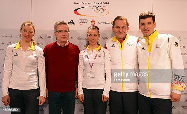 German Minister of the Interior Thomas de Maiziere poses with Denise Herrmann Stefanie Boehler president of the German Olympic Sports Confederation...