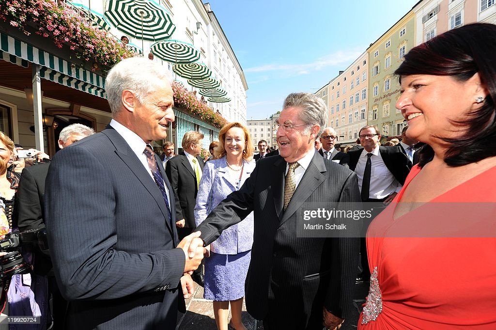 German Minister of Transport Peter Ramsauer (L), Austrian Federal President <a gi-track='captionPersonalityLinkClicked' href=/galleries/search?phrase=Heinz+Fischer&family=editorial&specificpeople=537198 ng-click='$event.stopPropagation()'>Heinz Fischer</a> and Salzburg Governor Gabi Burgstaller attend the opening reception during the Salzburg Festival at Felsenreitschule on July 27, 2011 in Salzburg, Austria.