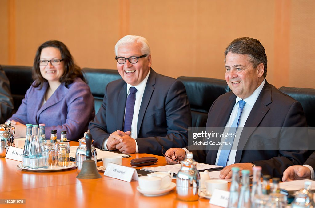 German Minister of Work and Social Issues <a gi-track='captionPersonalityLinkClicked' href=/galleries/search?phrase=Andrea+Nahles&family=editorial&specificpeople=822618 ng-click='$event.stopPropagation()'>Andrea Nahles</a>, German Foreign Minister <a gi-track='captionPersonalityLinkClicked' href=/galleries/search?phrase=Frank-Walter+Steinmeier&family=editorial&specificpeople=603500 ng-click='$event.stopPropagation()'>Frank-Walter Steinmeier</a> and German Economy Minister and Vice Chancellor <a gi-track='captionPersonalityLinkClicked' href=/galleries/search?phrase=Sigmar+Gabriel&family=editorial&specificpeople=543927 ng-click='$event.stopPropagation()'>Sigmar Gabriel</a> (L-R) attend the meeting of German Government Cabinet in Chancellery on July 29, 2015 in Berlin, Germany.