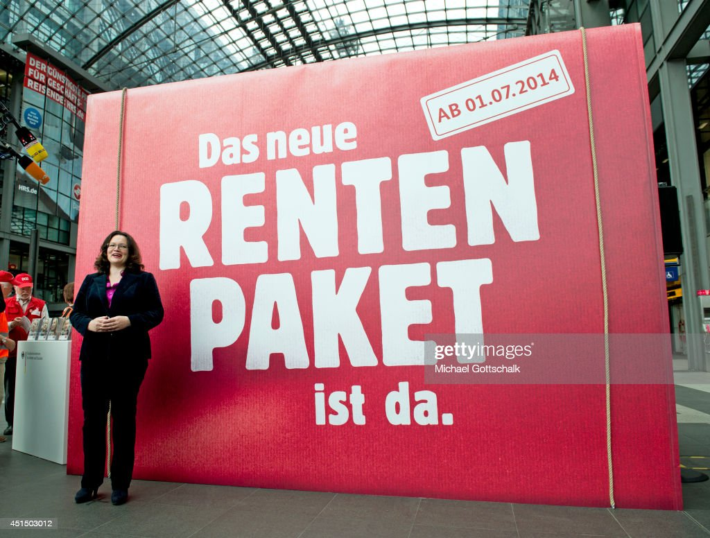 German Minister of Work and Social Issues <a gi-track='captionPersonalityLinkClicked' href=/galleries/search?phrase=Andrea+Nahles&family=editorial&specificpeople=822618 ng-click='$event.stopPropagation()'>Andrea Nahles</a> stands in front of a infomation point for German government pensions reform (Rentenpaket) in Berlin Main Station on June 30, 2014 in Berlin, Germany.