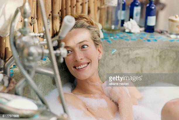 German model and actress Tatjana Patitz at home in the bath