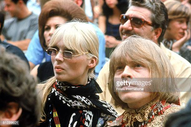 1967 German model and singer Nico of the Velvet Underground and British musician Brian Jones of the Rolling Stones sit in the audience at the...