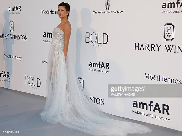 German model Barbara Meier poses as she arrives for the amfAR 22st Annual Cinema Against AIDS during the 68th Cannes Film Festival at Hotel du...