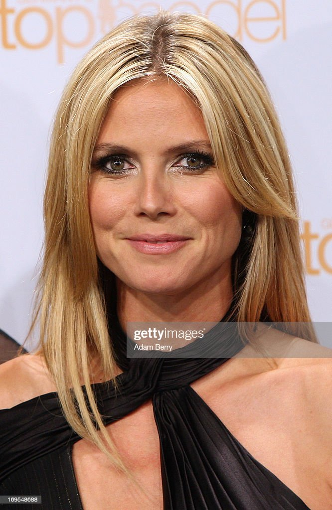 German model Heidi Klum poses at a photo call for the reality television show and modeling competition Germany's Next Topmodel at the Waldorf Astoria hotel on May 27, 2013 in Berlin, Germany. The show is currently in its eighth cycle and Klum is the lead judge and executive producer of the show.