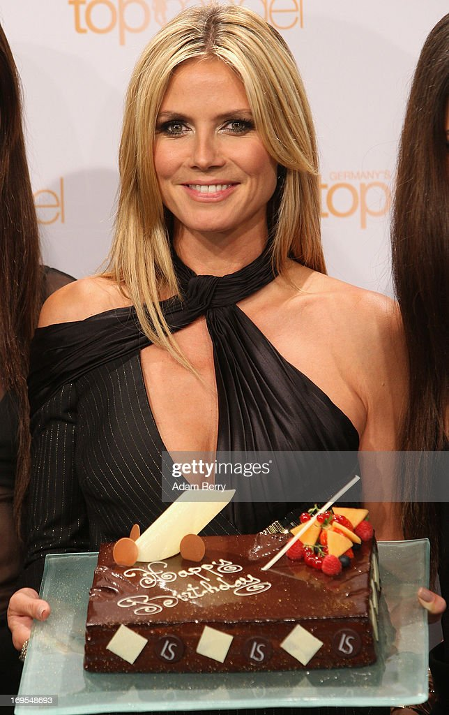 German model Heidi Klum poses with a birthday cake for her upcoming June 1 birthday at a photo call for the reality television show and modeling competition Germany's Next Topmodel at the Waldorf Astoria hotel on May 27, 2013 in Berlin, Germany. The show is currently in its eighth cycle and Klum is the lead judge and executive producer of the show.