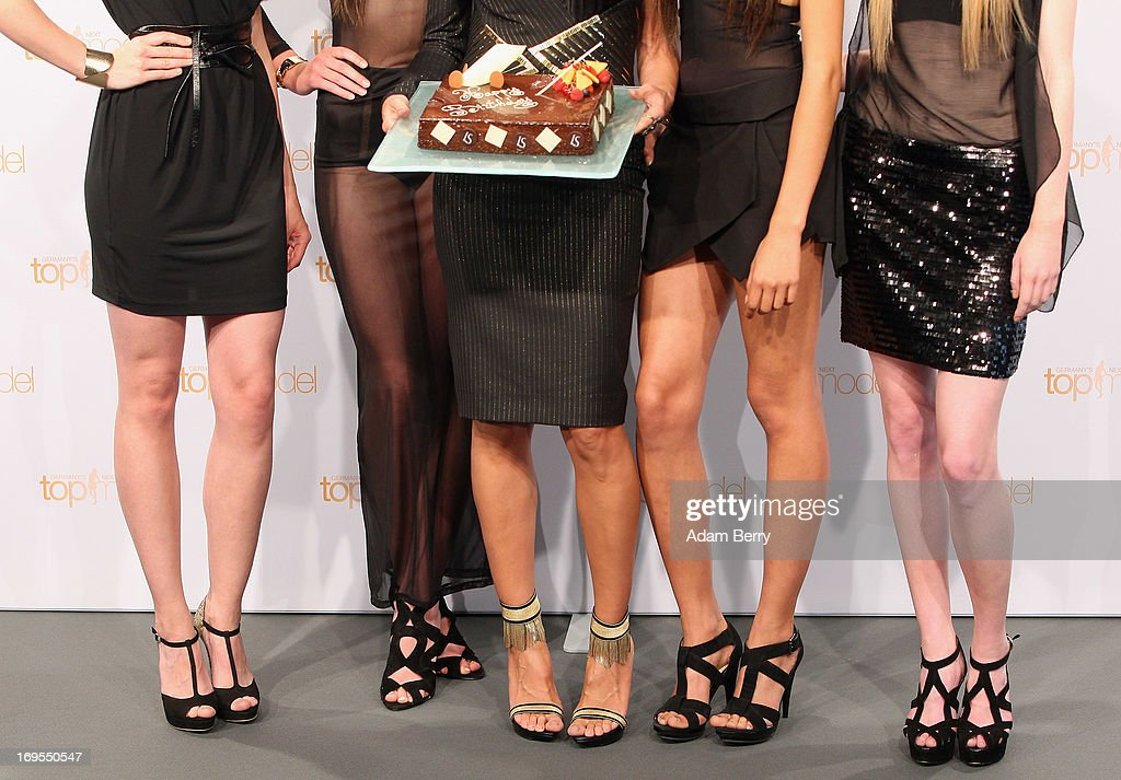 German model Heidi Klum (C) poses with (L to R) contestants Sabrina Elsner, Luise Will, Lovelyn Enebechi and Maike van Grieken with a birthday cake prior to Klum's June 1 birthday at a photo call for the reality television show and modeling competition Germany's Next Topmodel at Waldorf Astoria on May 27, 2013 in Berlin, Germany. The show is currently in its eighth cycle and Klum is the lead judge and executive producer of the show.