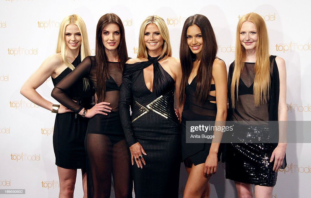 German model <a gi-track='captionPersonalityLinkClicked' href=/galleries/search?phrase=Heidi+Klum&family=editorial&specificpeople=178954 ng-click='$event.stopPropagation()'>Heidi Klum</a> (C) poses with (L to R) contestants Sabrina Elsner, Luise Will, Lovelyn Enebechi and Maike van Grieken at a photo call for the reality television show and modeling competition Germany's Next Topmodel at Waldorf Astoria on May 27, 2013 in Berlin, Germany.