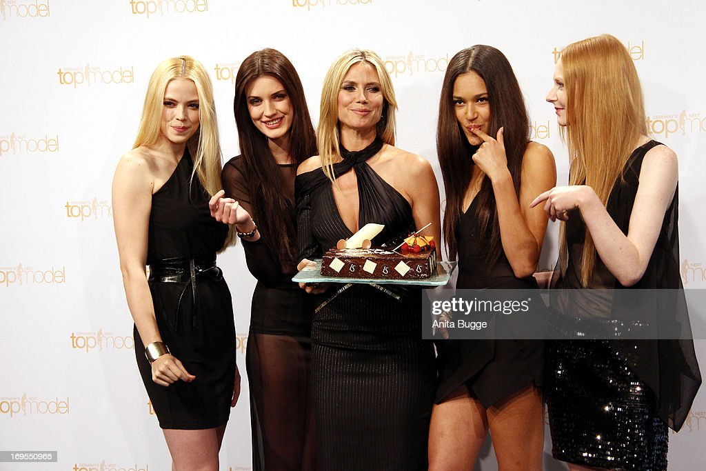 German model <a gi-track='captionPersonalityLinkClicked' href=/galleries/search?phrase=Heidi+Klum&family=editorial&specificpeople=178954 ng-click='$event.stopPropagation()'>Heidi Klum</a> (C) poses with (L to R) contestants Sabrina Elsner, Luise Will, Lovelyn Enebechi and Maike van Grieken with a birthday cake prior to Klum's June 1 birthday at a photo call for the reality television show and modeling competition 'Germany's Next Topmodel' at Waldorf Astoria on May 27, 2013 in Berlin, Germany.
